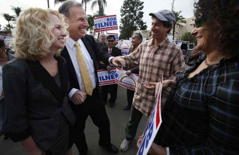 Bronwyn Ingram, left, and Bob Filner arrive at Balboa Park Club Monday for the inauguration of the new city council.