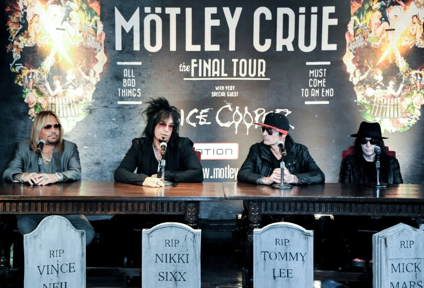 "Motley Crue is shown at a Los Angeles press conference in Los Angeles in January 2014, when the band announced its ""final tour"" and signed a ""cessation of touring agreement"" that it declined to share with the press. Today, Dec. 4, the band announced its reunion tour. From left, at that 2014 press conference, are band members Vince Neil, Nikki Sixx, Tommy Lee and Mick Mars."