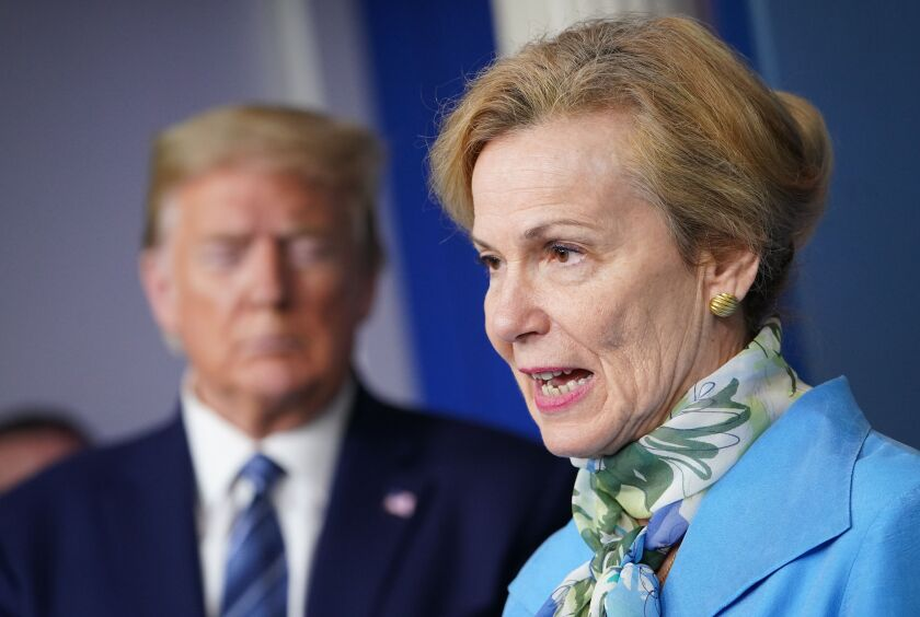 Dr. Deborah Birx, response coordinator for White House Coronavirus Task Force, speaks as President Trump listens during the daily briefing on COVID-19 on Tuesday at the White House.