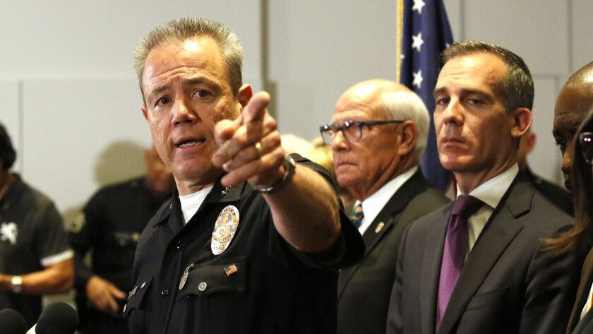 Los Angeles Police Department Chief Michel Moore addresses a news conference at LAPD headquarters.