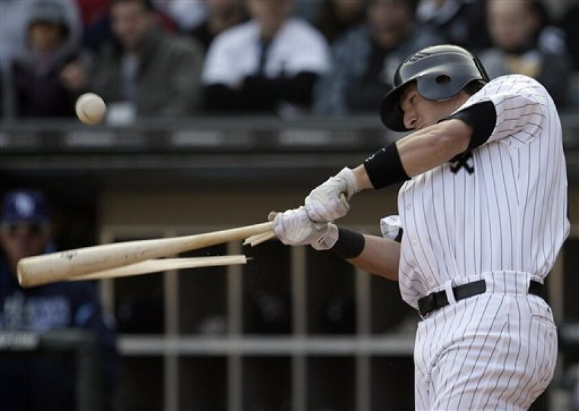 Chicago White Sox's Brent Morel hits an RBI single against the Tampa Bay Rays during the fourth inning of a baseball game in Chicago, Saturday, April 9, 2011. (AP Photo/Nam Y. Huh)
