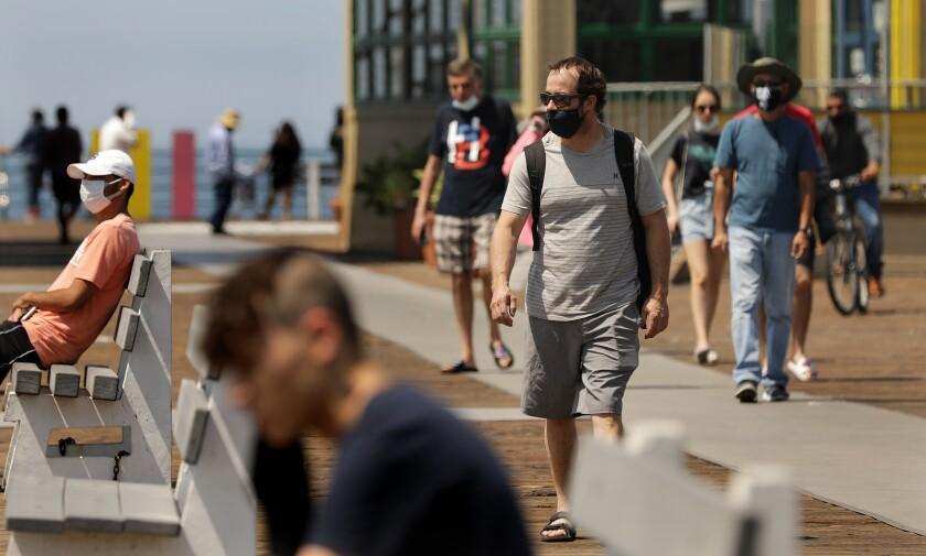 People visit the Santa Monica Pier on July 21.