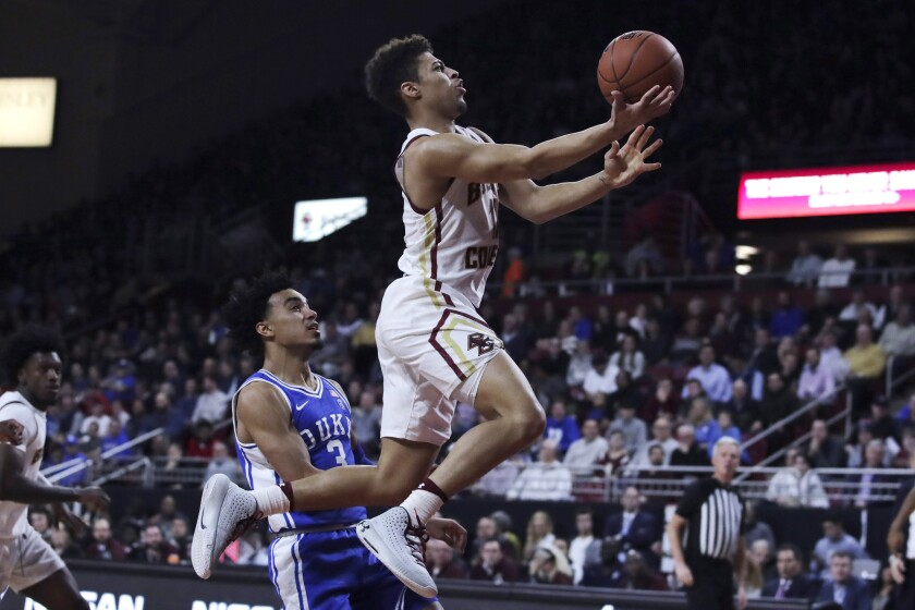 Boston College guard Derryck Thornton, right, drives to the basket past Duke guard Tre Jones (3) during the second half of an NCAA college basketball game in Boston, Tuesday, Feb. 4, 2020. (AP Photo/Charles Krupa)