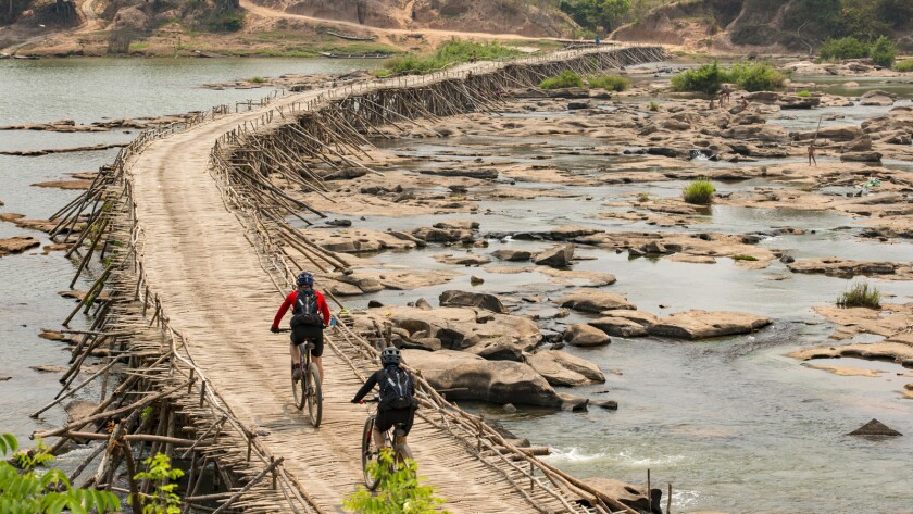 "Rebecca Rusch and Huyen Nguyen ride the Ho Chi Minh Trail in the documentary ""Blood Road."""