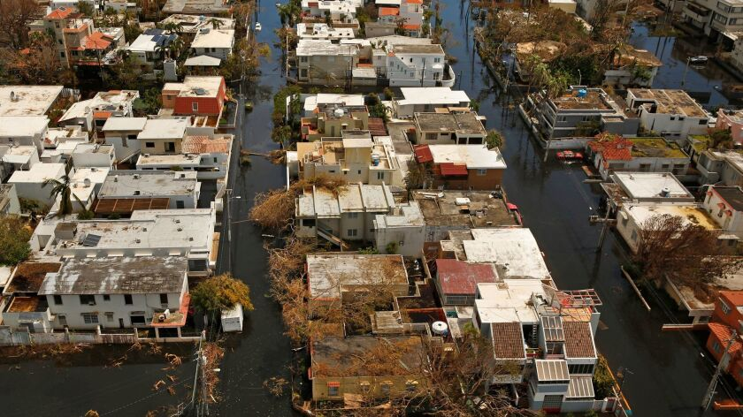 Hurricane Maria toppled electrical wires, trees and vegetation in much of San Juan, even ripping roo