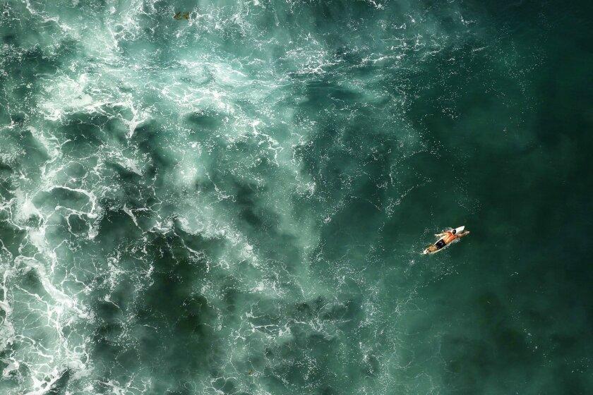 SAN DIEGO, CA-OCTOBER 7, 2015   A surfer paddles at Windansea Beach in La Jolla.   (K.C. Alfred/ San Diego Union-Tribune