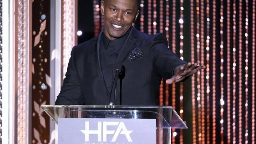 FILE - In this Nov. 1, 2015 file photo, Jamie Foxx presents the Hollywood actor award at the Hollywood Film Awards at the Beverly Hilton Hotel in Beverly Hills, Calif. Foxx has played super villains and antiheroes on screen. The role of super hero he apparently saved for real life. Foxx and the victim's father say Tuesday, Jan. 19, 2016, that Foxx and one other hero pulled a man from his burning truck moments before it became engulfed in flames near Foxx's Southern California home. (Photo by Chris Pizzello/Invision/AP, File) (/ The Associated Press)