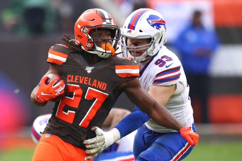 Cleveland Browns running back Kareem Hunt carries the ball in front of Buffalo Bills defensive end Trent Murphy.