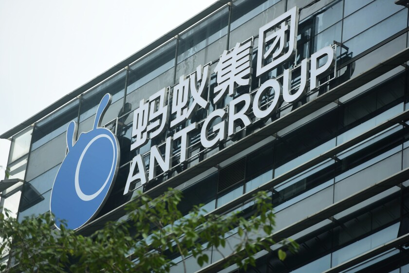 FILE - In this Oct. 26, 2020, file photo, a view of the signage of Ant Group is seen at the headquarters compound of the fintech giant in Hangzhou in eastern China's Zhejiang province. The CEO of Ant Group, the world's biggest financial technology company, has resigned from the company due to personal reasons. Ant Group thanked Simon Hu on Friday, March 12, 2021, for his contributions to the business. He had served as CEO since 2019. (Chinatopix Via AP, File)