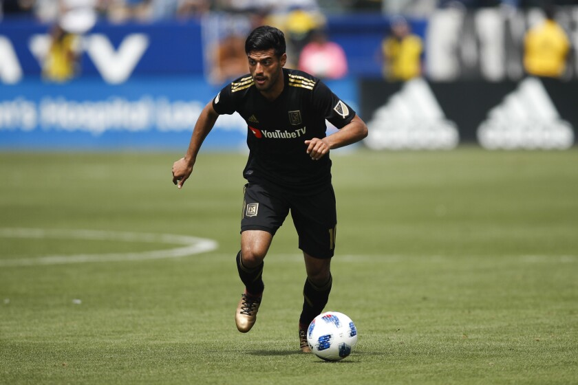 Los Angeles FC's Carlos Vela dribbles the ball during the first half of an MLS soccer match against the Los Angeles Galaxy Saturday, March 31, 2018, in Carson, Calif.