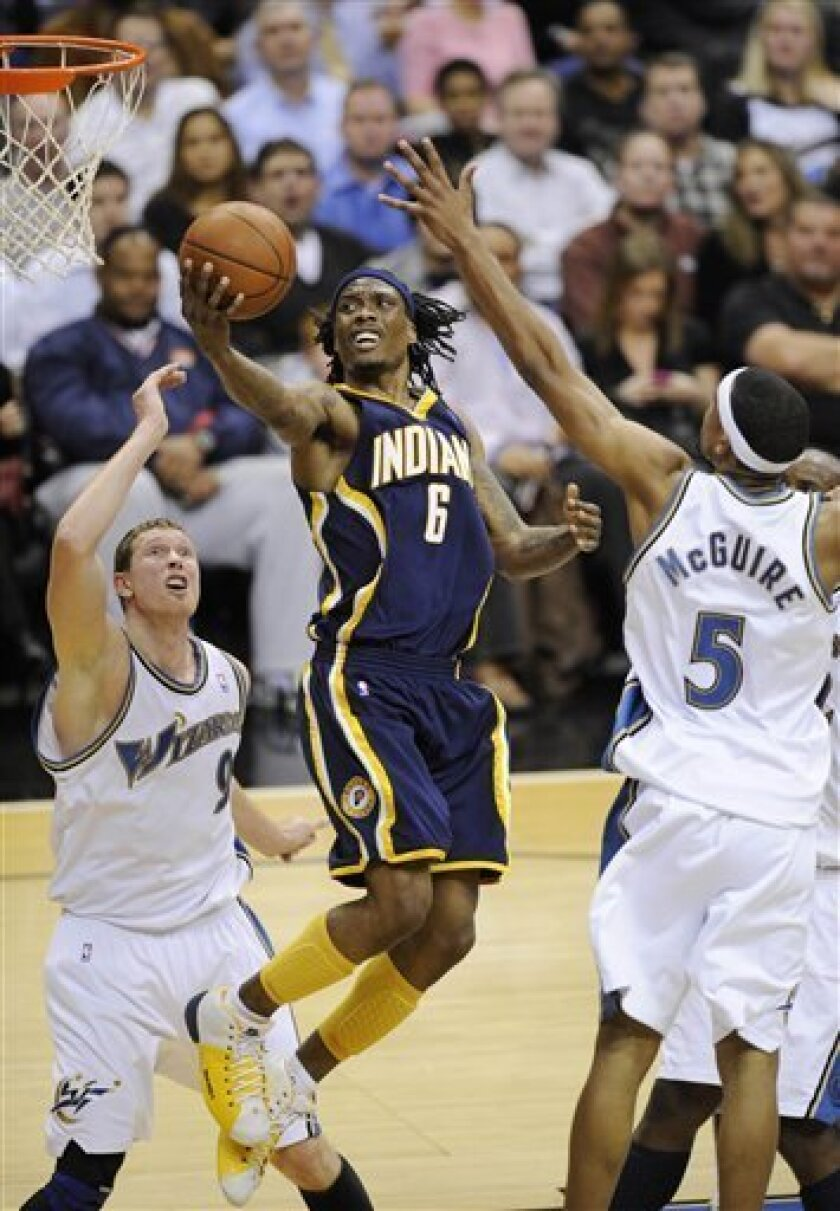 Indiana Pacers' Marquis Daniels (6) goes to the basket between Washington Wizards' Darius Songaila (9) of Lithuania and Dominic McGuire (5) during the second quarter of an NBA basketball game, Monday, Dec. 15, 2008, in Washington.(AP Photo/Nick Wass)
