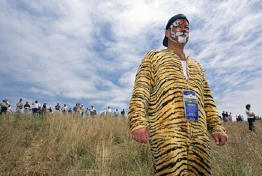 A Tiger Woods fan dressed in a tiger suit and makeup at the 2000 U.S. Open at Pebble Beach.