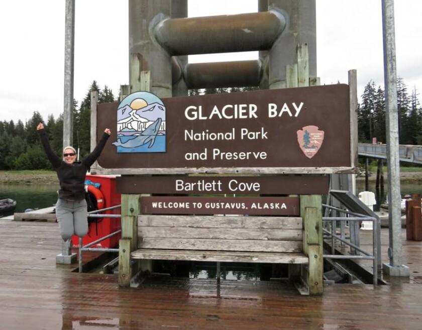 Andrea Kalash celebrates arriving at her 59th and final national park, Glacier Bay National Park and Preserve in Alaska on Aug. 11, 2016.
