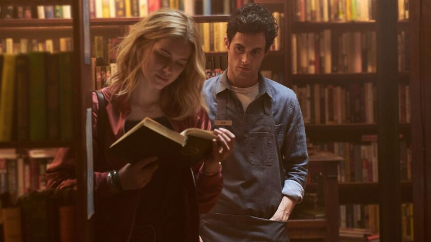 """Elizabeth Lail and Penn Badgley in the creepy, addictive thriller """"You,"""" which premieres Sunday on Lifetime."""