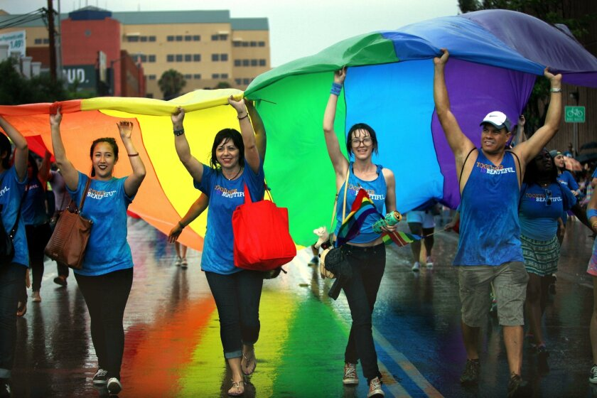Last year's rain didn't stop participants from carrying the rainbow flag down the streets of Hillcrest during the LGBT Pride Parade.