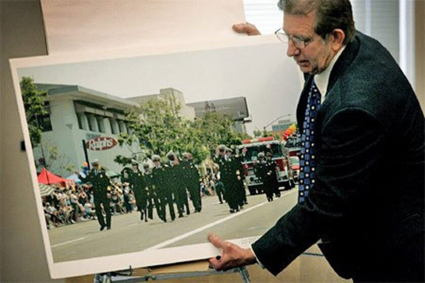 In closing arguments yesterday in a sexual-harassment suit by four San Diego firefighters, Deputy City Attorney Don Shanahan showed jurors an image of fire personnel marching in the 2007 gay-pride parade in Hillcrest. (Bruce K. Huff / Union-Tribune)