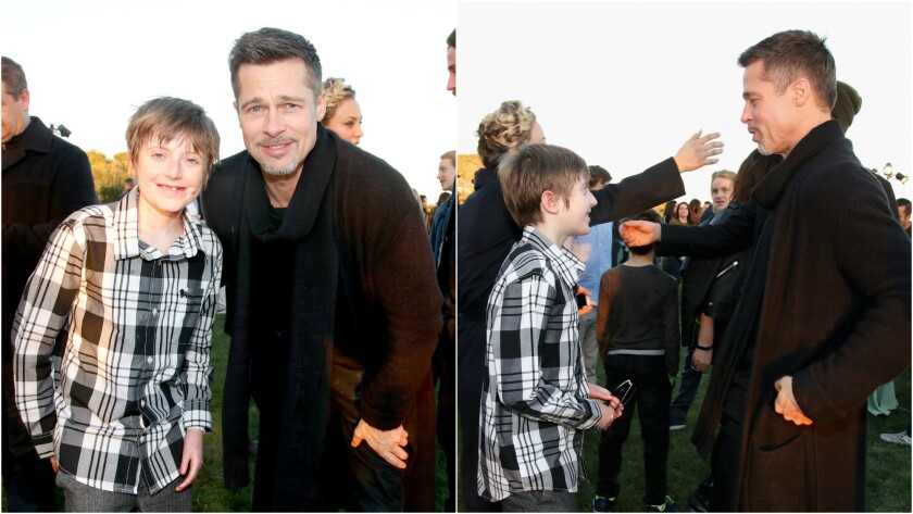 Brandon Joseph, left, is joined by Brad Pitt and a group of celebrities during Saturday's benefit event for the Epidermolysis Bullosa Medical Research Foundation.