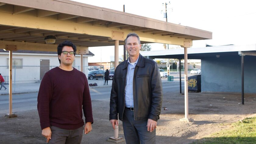 Robert Flores, senior scientist, left, and Jack Brouwer, associate director, both of UC Irvine's Advanced Power and Energy Program, are leading a project to turn Oak View into an energy-efficient area as part of a nationwide challenge.