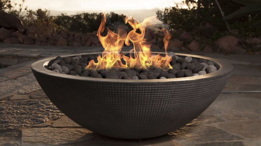 An outdoor space with a fire feature is a delightful way to an enjoy a cool summer evening.