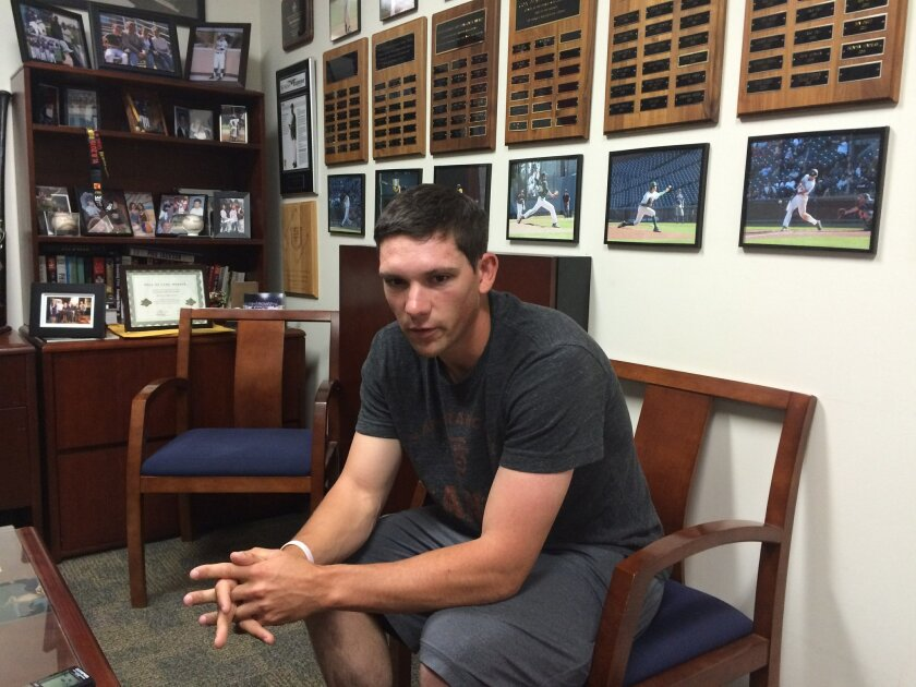 In this May 17, 2016, photo, University of San Francisco baseball player Joey Carney is interviewed at the school in San Francisco. On Wednesday morning, June 1, the pitcher and his mom, Paula, will check into the hospital together and wait for their respective transplant surgeries Thursday, where