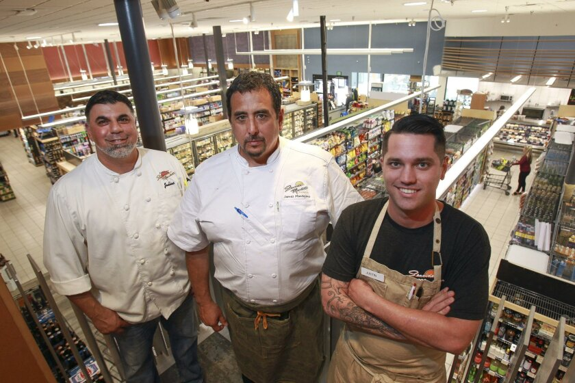 Cardiff Seaside Market's new executive chef James Montejano, center, with executive sous chef Justin Cullimore, right, and sous chef Julius Attiq, photographed from the store's new mezzanine level where cooking classes, wine dinners and special events will soon be hosted.