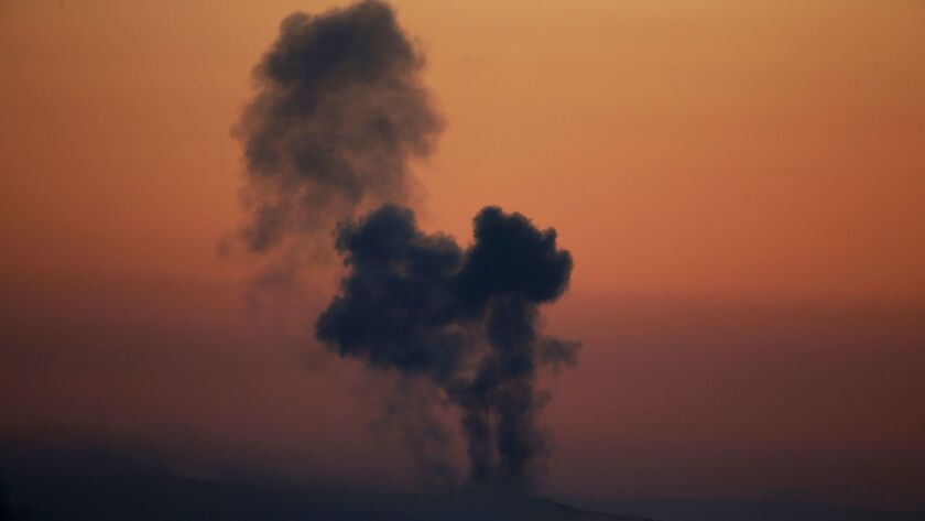 FILE - In this Saturday, Jan. 20, 2018 file photo, plumes of smoke rise on the air from inside Syria