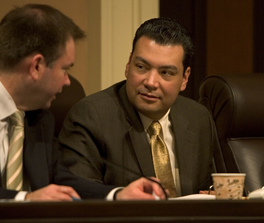 State Sen. Alex Padilla (D-Pacoima), right, listens to a staffer during a Senate committee hearing.