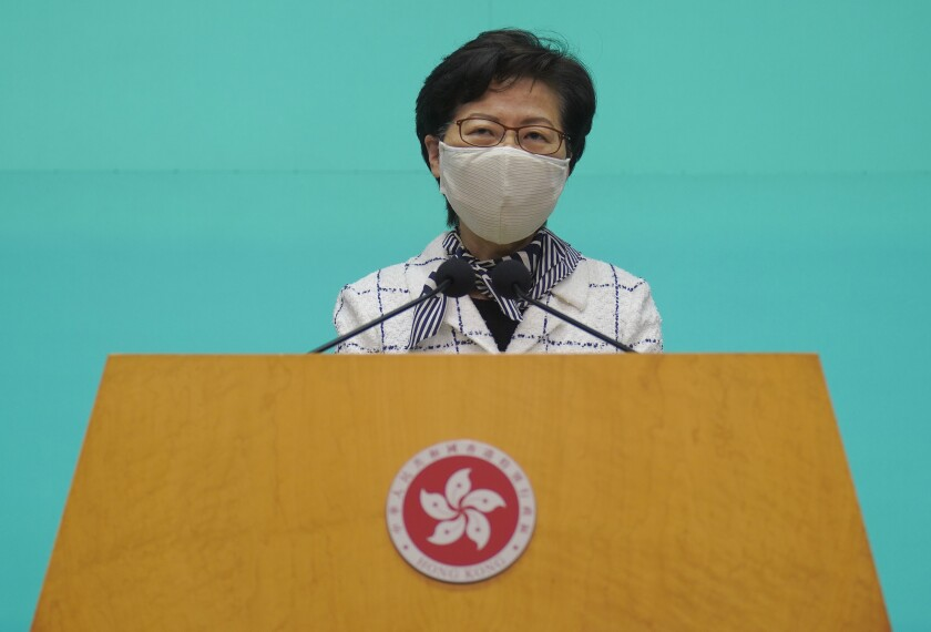 """Hong Kong Chief Executive Carrie Lam listens to reporters' questions during a press conference in Hong Kong, Tuesday, June 16, 2020. Lam said she hoped that the opposition would not """"demonize and stigmatize"""" the national security law as doing do would mean pitting themselves against the people of Hong Kong. (AP Photo/Vincent Yu)"""