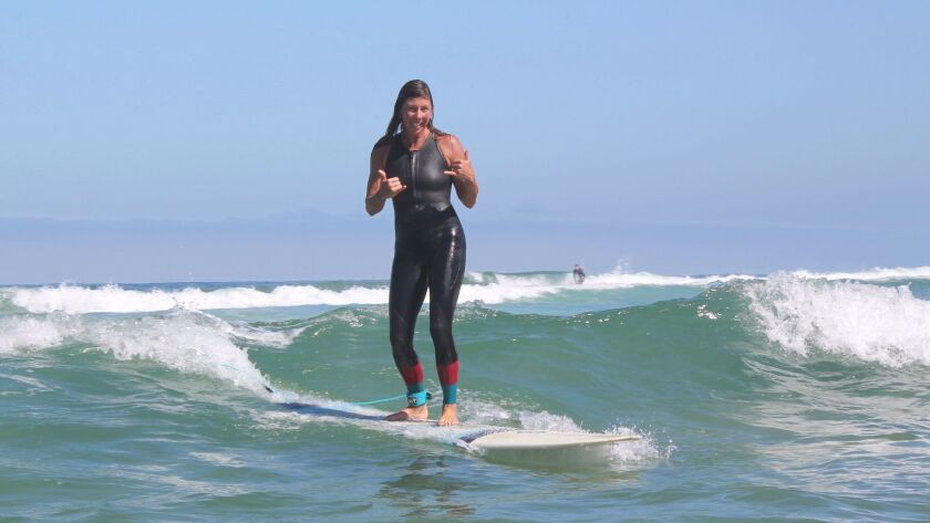 Valerie Juboori, one of the surf moms, rides a wave on her longboard June 28 at La Jolla Shores Beac