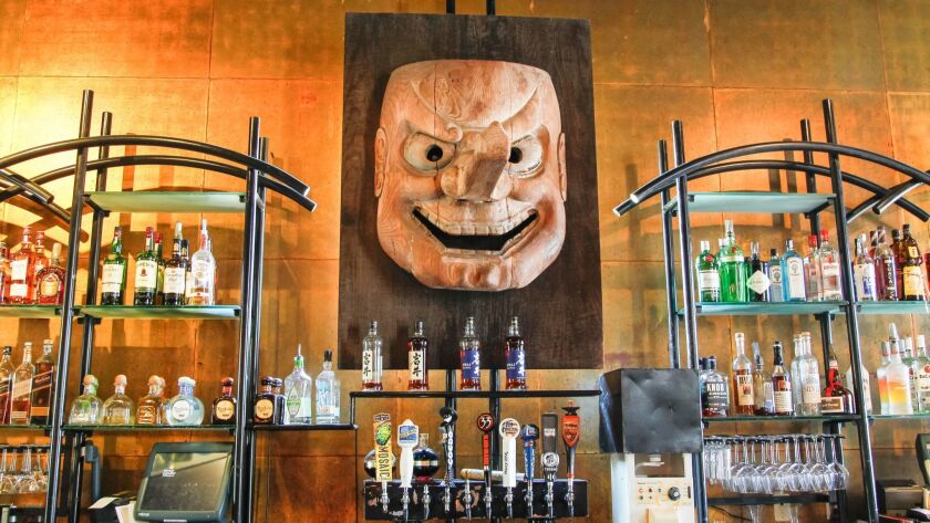 SAN DIEGO, CA June 13th 2018 | Large Tengu mask over the bar at Cafe Japengo on Wednesday in San Die
