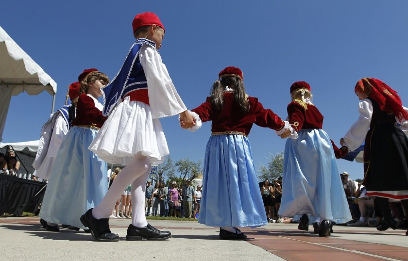 "Boys and girls of the traditional Greek dance group ""Opalakia"" preform for their friends and parents at the Cardiff Greek Festival in the Saints Constantine and Helen Greek Orthodox Church Sunday."