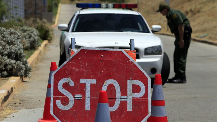 Agents staff a checkpoint on the road to the Murrieta Border Patrol facility in this 2014 photo. A man was arrested at a checkpoint in Salton City this week.