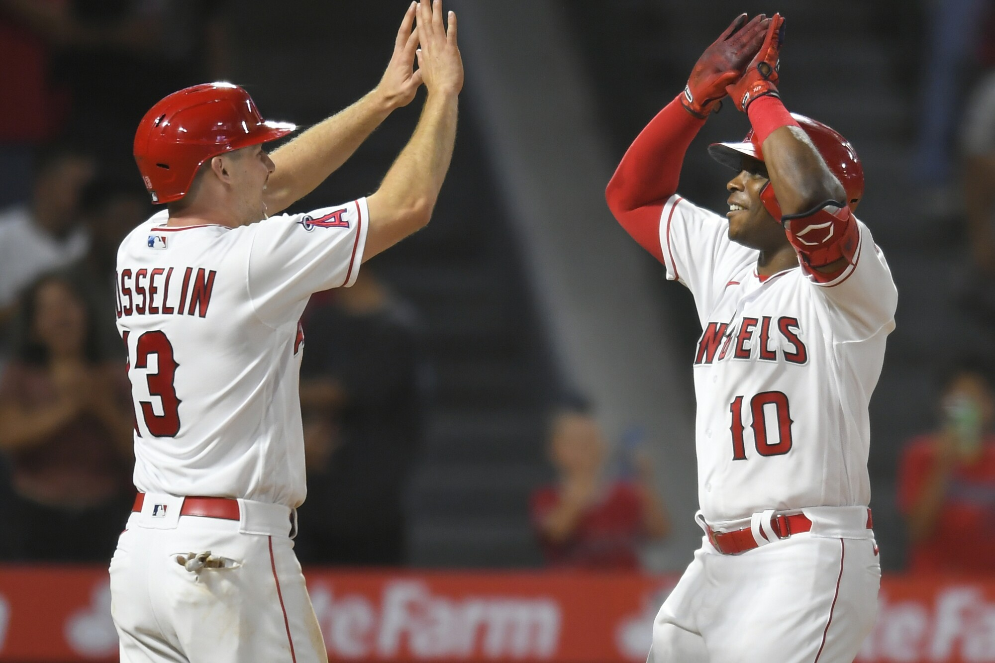 Angels first baseman Phil Gosselin waits to congratulate Justin Upton for his two-run home run.