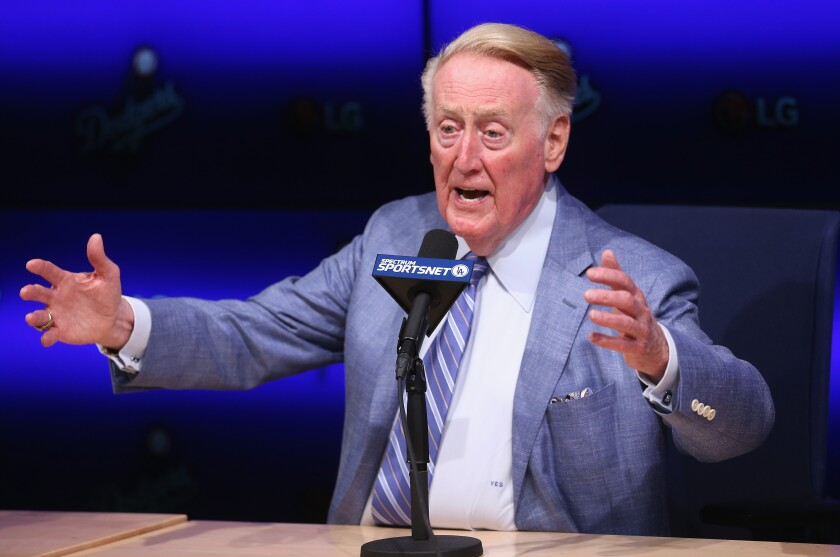 Former Dodgers announcer Vin Scully speaks during a news conference in 2014.