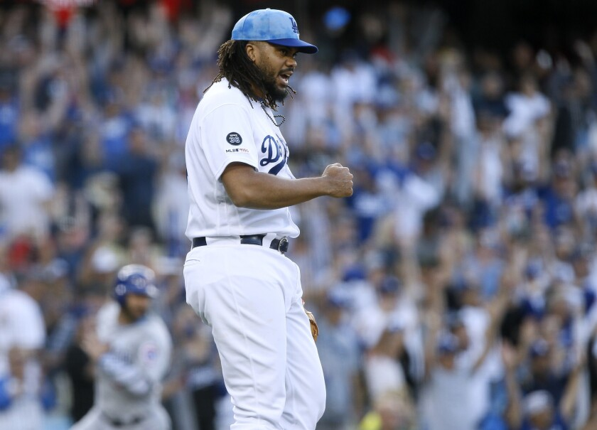 Los Angeles Dodgers relief pitcher Kenley Jansen reacts after the last out by the Chicago Cubs durin