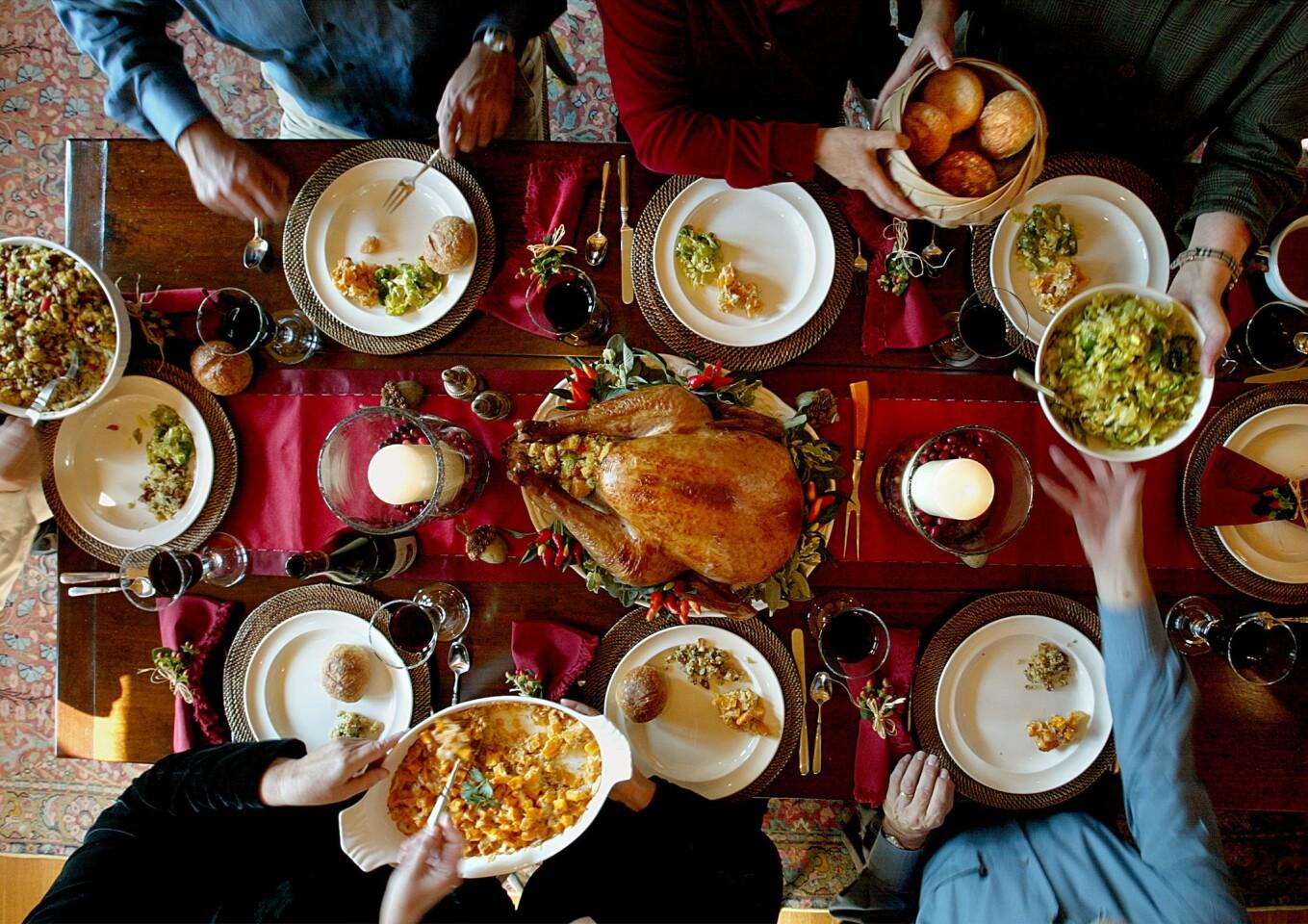 Soy-brined turkey, center; sausage-cornbread stuffing, left; and pumpkin-Gruyère gratin, bottom.