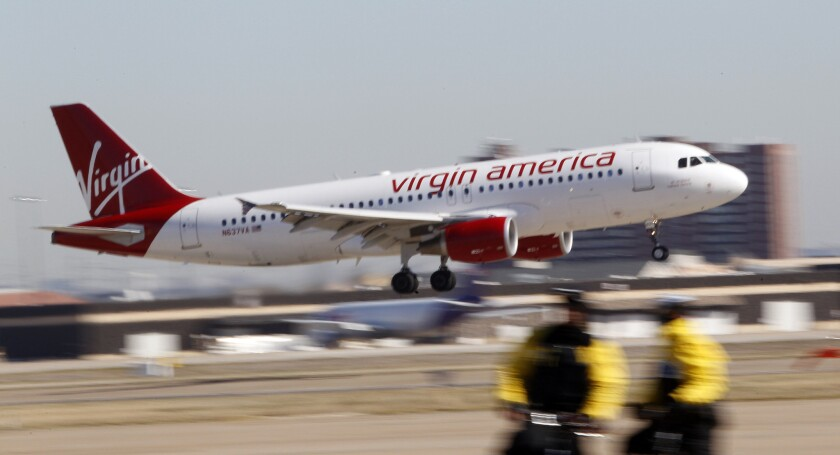 A Virgin America jet departs from Los Angeles International Airport. JetBlue Airways and Alaska Airlines have reportedly made offers to take over the California-based airline.