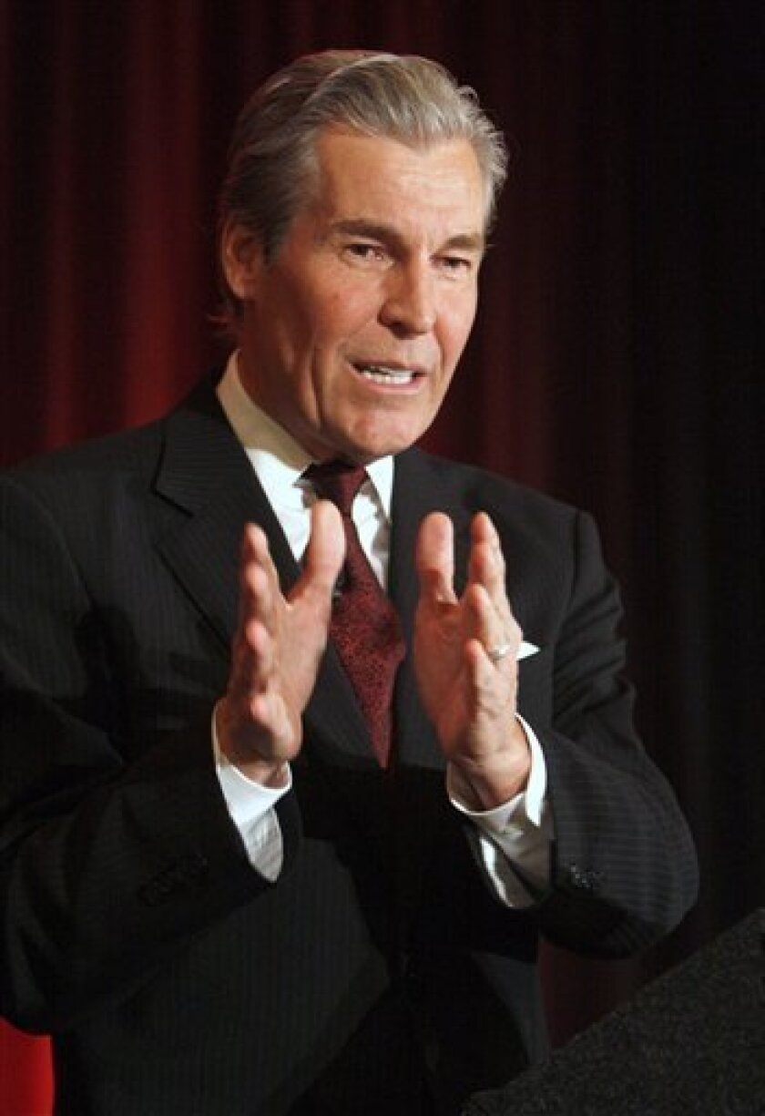 In this Sept. 24, 2008 file photo, Macy's chief executive Terry Lundgren speaks during the Cincinnati USA Regional Chamber luncheon in Cincinnati. Macy's said Thursday, Jan. 8, 2009, it will close 11 underperforming stores in 9 states _ affecting 960 employees _ after one of the weakest holiday s
