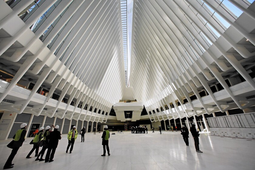 Members of the news media tour the World Trade Center transportation hub, designed by Spanish architect Santiago Calatrava. Its initial phase opens this week.
