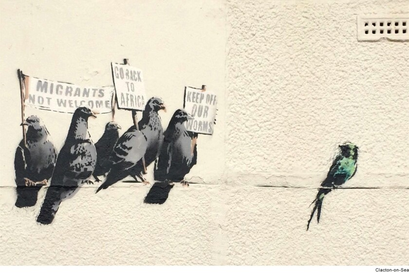An immigration-themed mural attributed to the British street artist known as Bansky was removed in England after accusations of racism.