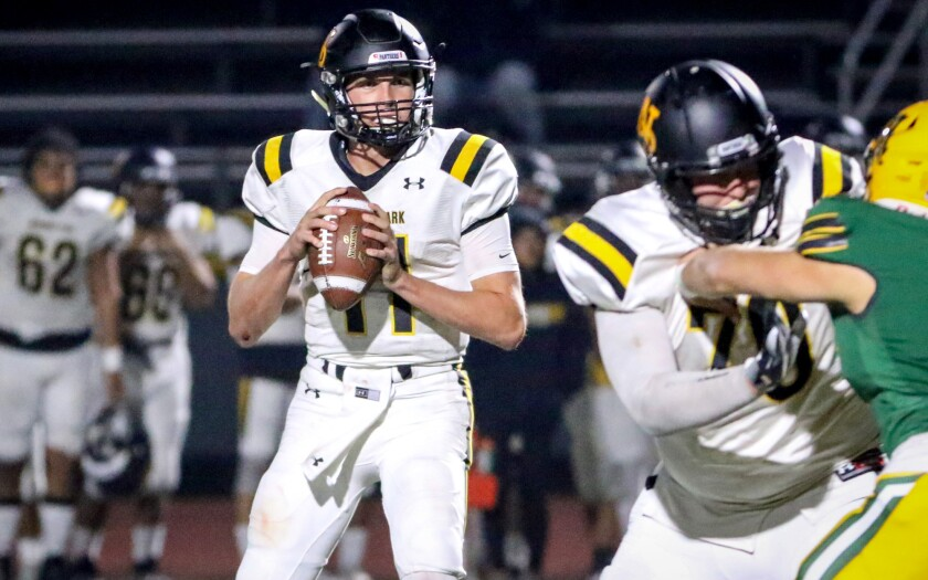 Newbury Park quarterback Ben Gulbranson drops back to pass in his high school finale against Moorpark on Nov. 1.