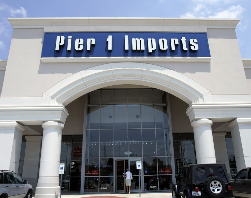 FILE - This June 15, 2005, file photo shows a Pier 1 Imports store in Dallas. Pier 1 Imports is closing nearly half its 942 stores as it struggles to draw consumers and compete online. The home decor company said Monday, Jan. 6, 2020, it is closing up to 450 stores and will also shutter distribution centers. It didn't say where the store closures would occur, but it operates stores in the U.S. and Canada. Pier 1 also plans layoffs at its corporate headquarters in Fort Worth, Texas. (AP Photo/Donna McWilliam, File)