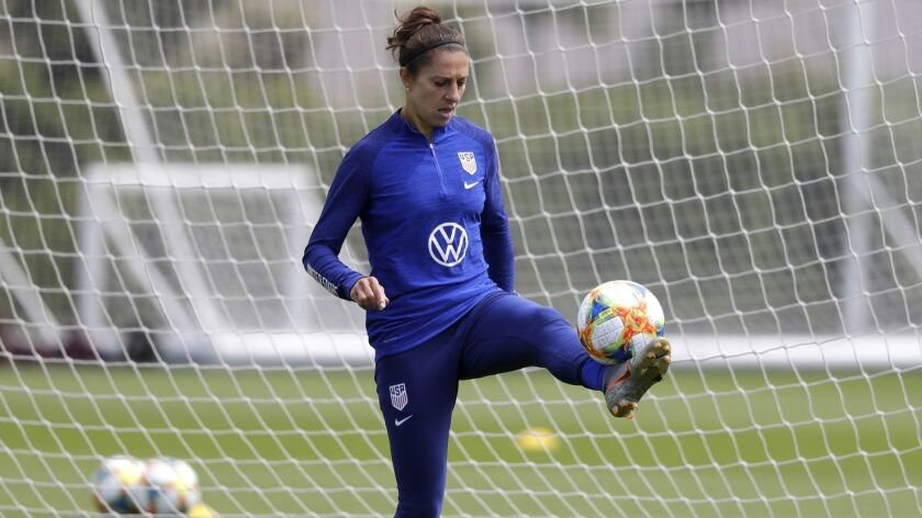 Carli Lloyd warms up during a training session at the Tottenham Hotspur facility in London earlier this week.