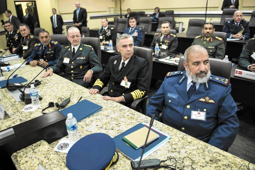 Defense chiefs from Turkey, the United Arab Emirates, Denmark, Spain, Qatar and other nations listen to an address by President Obama, not visible, at Andrews Air Force Base in Maryland.