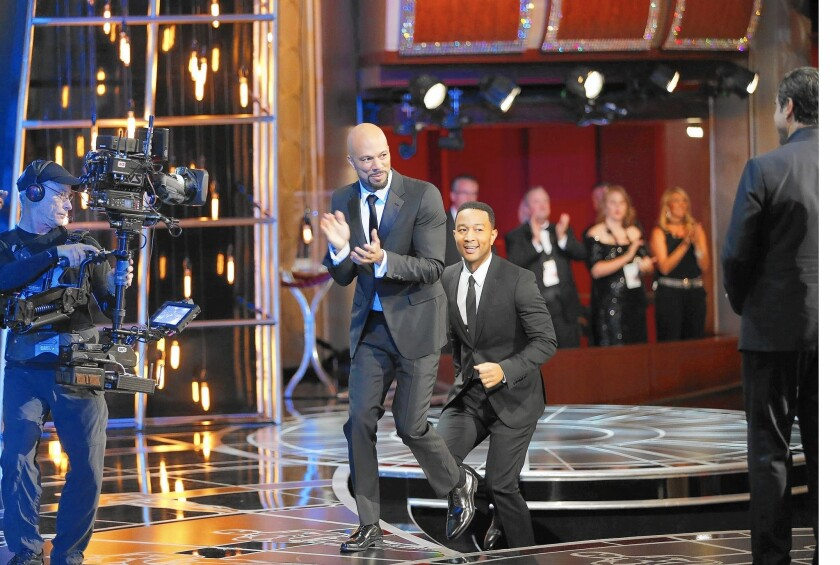 """Common, left, and John Legend celebrate winning the Oscar for original song for """"Glory"""" from """"Selma"""" at the 87th Academy Awards on Feb. 22, 2015, at the Dolby Theatre in Hollywood."""