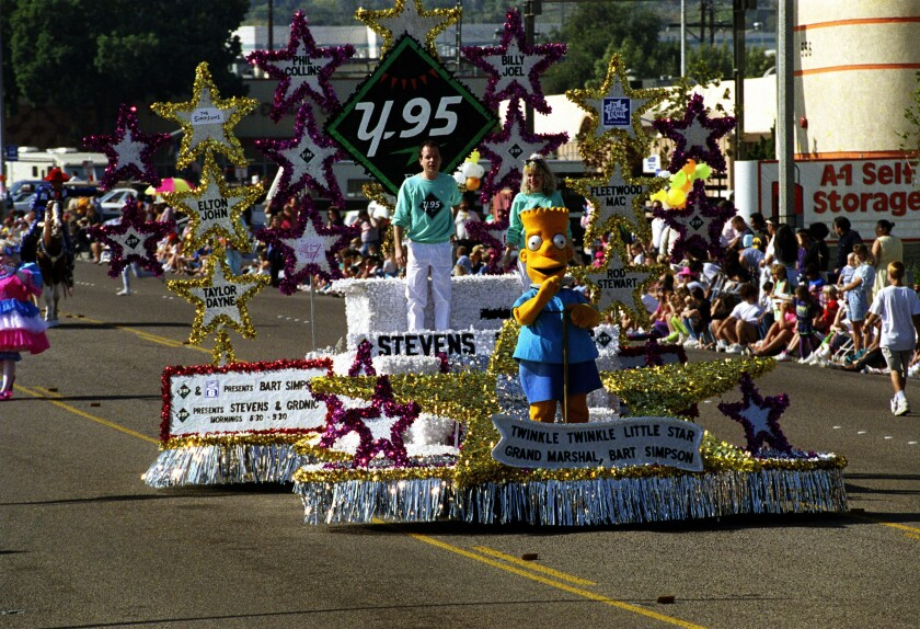Bart Simpson, 1990 Mother Goose Parade grand marshal, waves to the crowd.