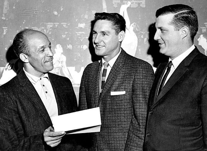 In 1962, George Steinbrenner, right, was owner of the American Basketball League champion Cleveland Pipers. With him are General Manager John McLendon, left, and Coach Bill Sharman. See full story