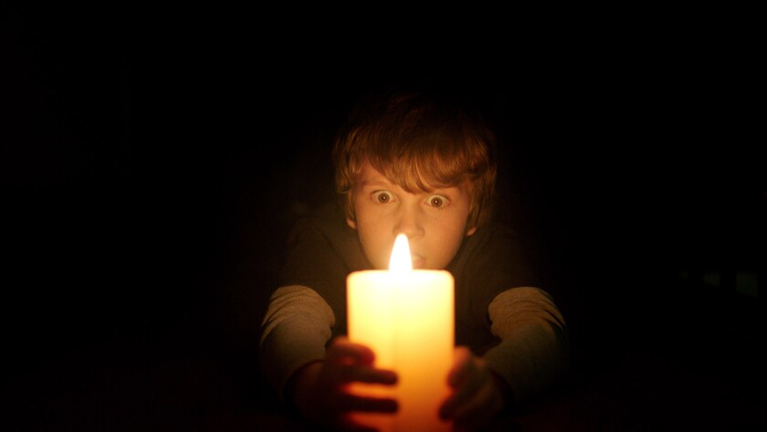 """Gabriel Bateman in the horror film """"Lights Out,"""" adapted from a viral YouTube video"""