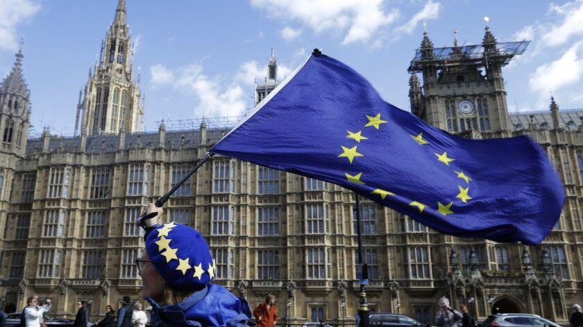 A woman waves a European Union flag in London on Monday.
