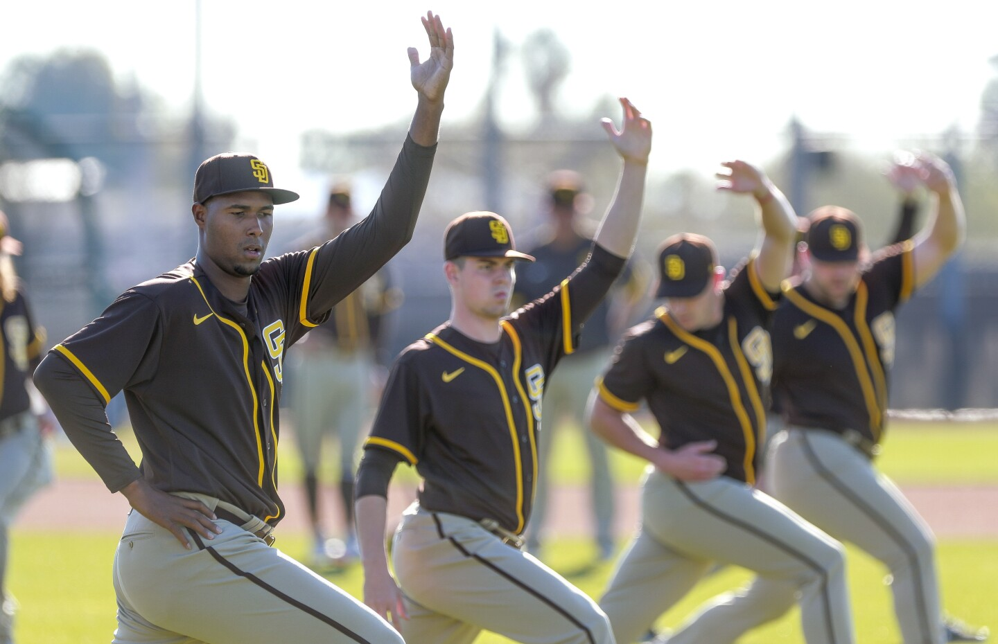The Padres' Dauris Valdez, left, MacKenzie Gore, second from left, and other pitchers stretch on a field during Padres spring training at the Peoria Sports Complex on Thursday, February 13, 2020 in Peoria, Arizona.